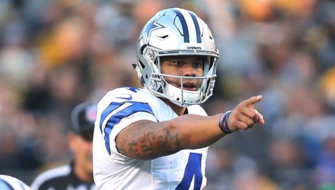 Dallas Cowboys quarterback Dak Prescott (4) gestures at the line of scrimmage against the Pittsburgh Steelers during the first quarter at Heinz Field.