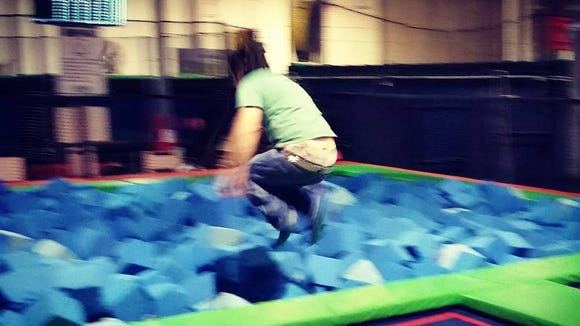 Kevin cannonballing into the foam pit
