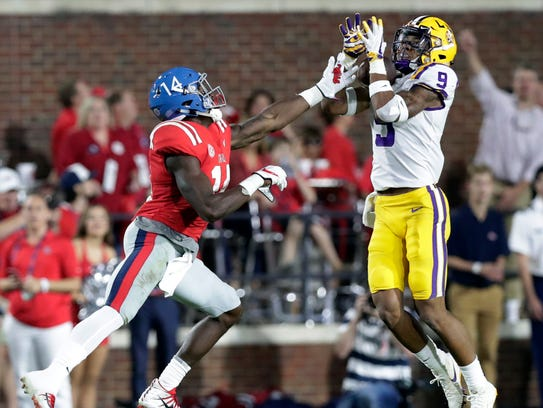 LSU safety Grant Delpit (9) intercepts a pass intended