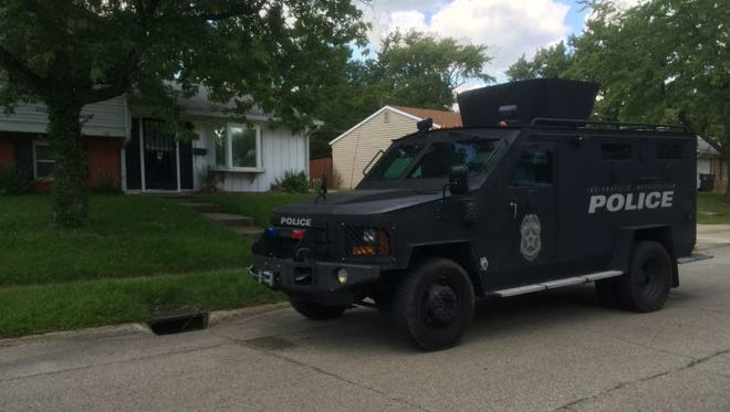 A police vehicle parks in front of a residence on the 6200 block of E. 44th Street on Sunday afternoon.