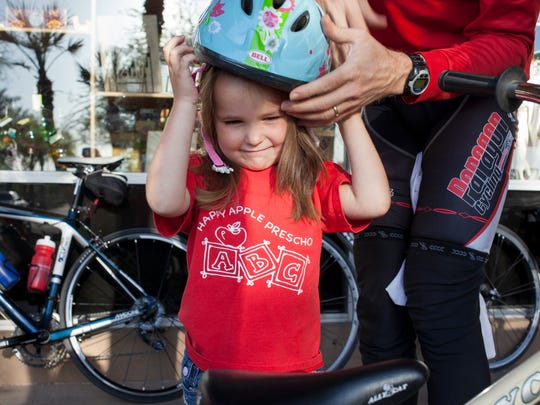 Hannah Royality gets help from her dad, Chuck Royality during Bike to Work Day.