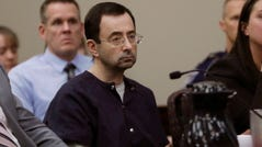 FILE - In this Jan. 24, 2018 file photo, Larry Nassar sits during his sentencing hearing in Lansing, Mich. Michigan State can't win enough football games this season to change the ugliness of the school's recent past. The Larry Nassar sex abuse scandal and lingering questions about the school's football and basketball programs have put the university under a bad spotlight. This year's football team is hoping that players have learned the right lessons. The players remind each other to make good choices and avoid stupid behavior. (AP Photo/Carlos Osorio, File)