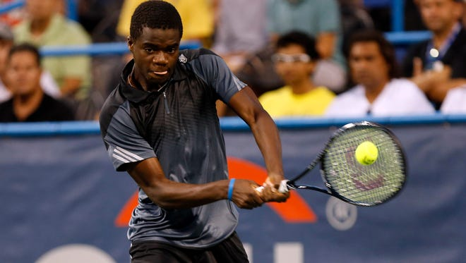 Francis Tiafoe hits a backhand against Evgeny Donskoy (not pictured) on day one of the Citi Open tennis tournament at the Fitzgerald Tennis Center.