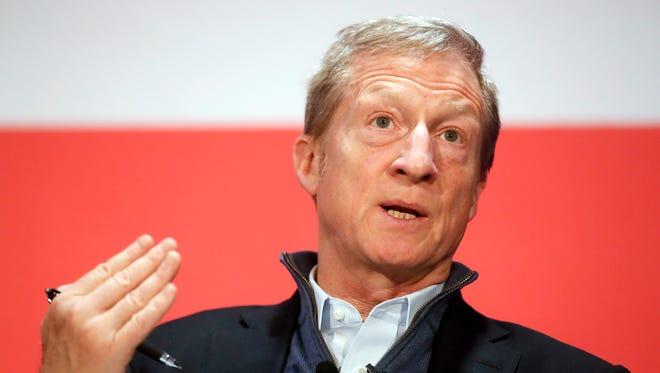 "Political activist Tom Steyer speaks during a ""Need to Impeach"" town hall event at the Clifton Cultural Arts Center, Friday, March 16, 2018, in Cincinnati."