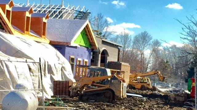 Construction workers take advantage of a cold but sunny day to build the new firehouse in Indian Hill.