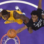 Minnesota Timberwolves guard Andrew Wiggins, right, shoots as Los Angeles Lakers forward Julius Randle defends during the second half Tuesday, Feb. 2, in Los Angeles.