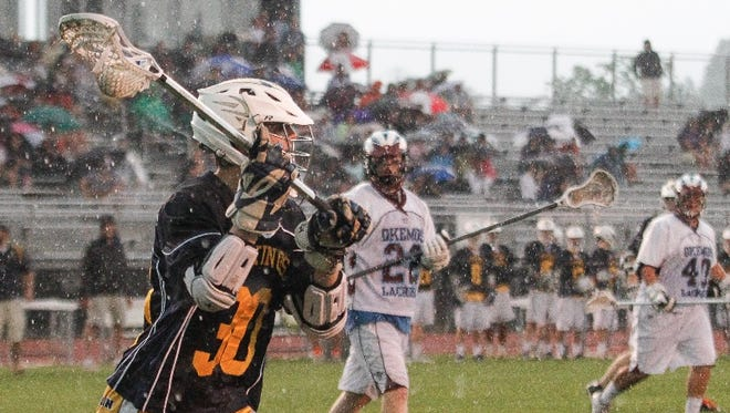 Haslett/Williamston's Logan Fenech (foreground) is one of the Lansing area's top lacrosse players heading into the 2017 season.