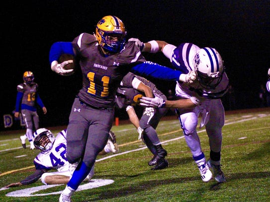 Waynesboro's Forrest Rhyne breaks a tackle during a
