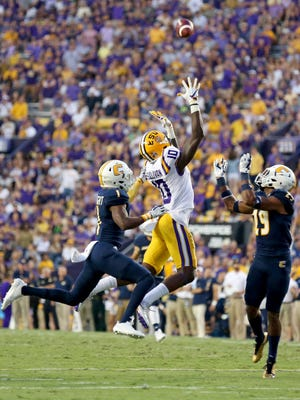 LSU wide receiver Stephen Sullivan (10) catches a 57-yard pass as Chattanooga defensive back Trevor Wright (1) and defensive back Lucas Webb (29) cover during the first half of an NCAA college football game in Baton Rouge, La., Saturday, Sept. 9, 2017.