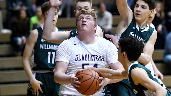 Fowlerville's Trevor Miller grabs a rebound during the fourth quarter on Wednesday, March 7, 2018, at the Don Johnson Field House in Lansing. Williamston beat Fowlerville 76-23.