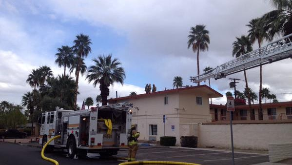 Palm Springs firefighters are at the scene of a building fire on South Palm Canyon Drive. At least two people were injured.