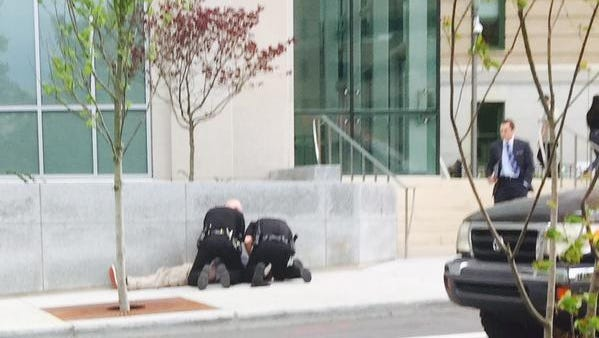 A man collapsed from an apparent cardiac arrest in front of the federal courthouse Thursday afternoon. Emergency staff were able to reestablish a pulse rate before taking him to Mission Hospital.
