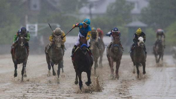 American Pharoah, ridden by Victor Espinoza, center, wins the 140th Preakness Stakes horse race at Pimlico Race Course, Saturday, May 16, 2015, in Baltimore.