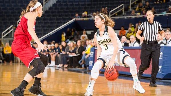 Katelynn Flaherty (right) has been dominant at Michigan.
