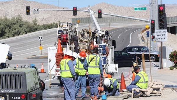 Coachella Valley Water District crews repair a water line on Bob Hope Drive at Ramon Road in Rancho Mirage Monday.