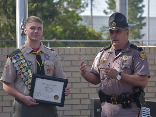 Eagle Scout Wyatt Moore, 16,  holds his recognition