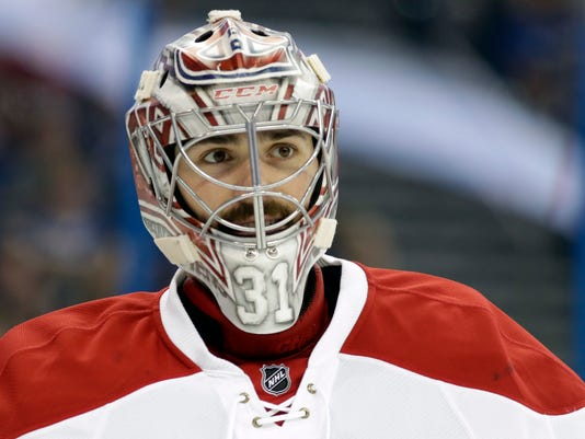 FILE - This April 1, 2017 file photo shows Montreal Canadiens goalie Carey Price during the second period of an NHL hockey game against the Tampa Bay Lightning in Tampa, Fla. The Canadiens have signed Price to an eight-year contract extension. General manager Marc Bergevin announced the deal Sunday, July 2, 2017 the second day Price was eligible to be extended. (AP Photo/Chris O'Meara)