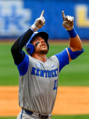 Kentucky catcher Kole Cottam (13) celebrates after hitting a home run during the first inning of a Southeastern Conference NCAA college baseball game against Auburn, Tuesday, May 22, 2018, in Hoover, Ala. (AP Photo/Butch Dill)