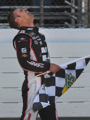 Clint Bowyer (14) celebrates after winning the STP 500 at Martinsville Speedway.