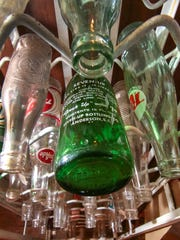A Seven-Up bottle from the 1960s, among many collectibles at the Old Depot Antique Mall in Anderson, bring back memories of when sodas were bottled in the Anderson area.