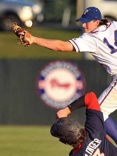 Madison Ridgeland Academy's Corey Olinger slides into second as Jackson Prep's Rob Huffman misses the throw to base during their game Tuesday at Jackson Prep in Flowood.