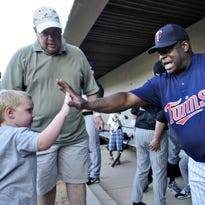 Former Minnesota Twin Al Newman high-fives a fan before a Twins Alumni Game at Joe Faber Field in 2010. He will be back at the field this season, this time as an assistant coach for the St. Cloud Rox.