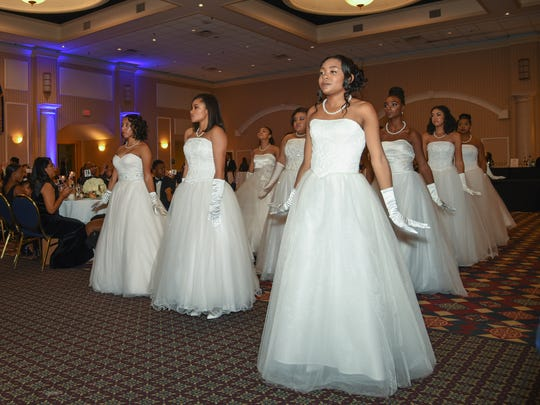 The young women's processional at the Jack and Jill Black and White Gala Nov. 18 at the Chase Center on the Riverfront.