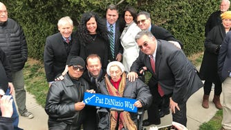 In front, Severo Jornacion, Jim Babjak and  Antoinette DiNizio at the dedication of Pat DiNizio Way in Scotch Plains in April 17.