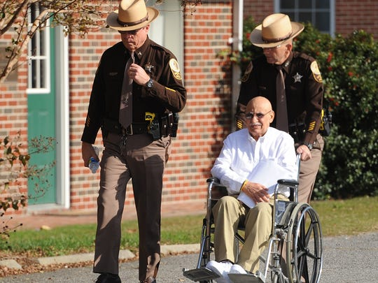Accomack County Sheriff's Deputies transport Khalil Muslimani, 68, from the Accomack County Jail to the Circuit Courthouse on Tuesday, Nov. 17, 2015 for a trial appearance. Muslimani was removed from court on a gurney after he complained of chest pains at the start of his last court date.