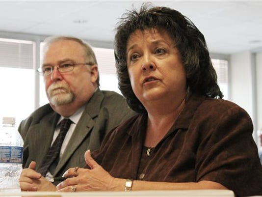 FILE - In this Friday, July 16, 2011, file photo, Secretary of State Dianna Duran, right, talks about her office's efforts to ensure the accuracy of the state's voter registration rolls during an interim legislative committee hearing in Albuquerque, N.M.