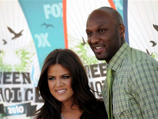 Khloe Kardashian and Lamar Odom arrive at the Teen Choice Awards on Sunday, Aug. 8, 2010 in Universal City, Calif. (AP Photo/Chris Pizzello)