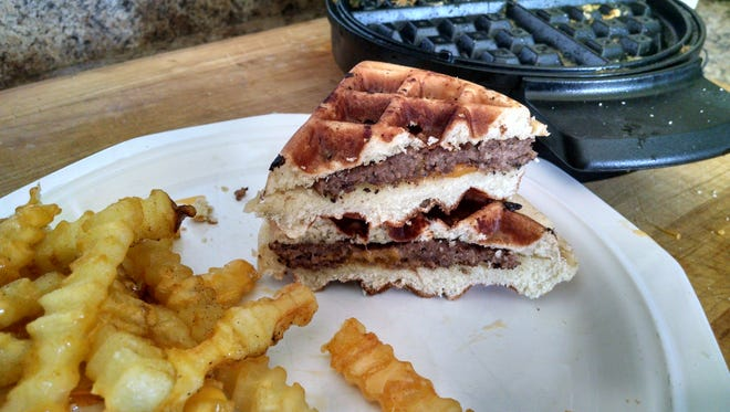 "The waffle iron can do so much more than cook its namesake. Here, a ""waffled"" cheeseburger."
