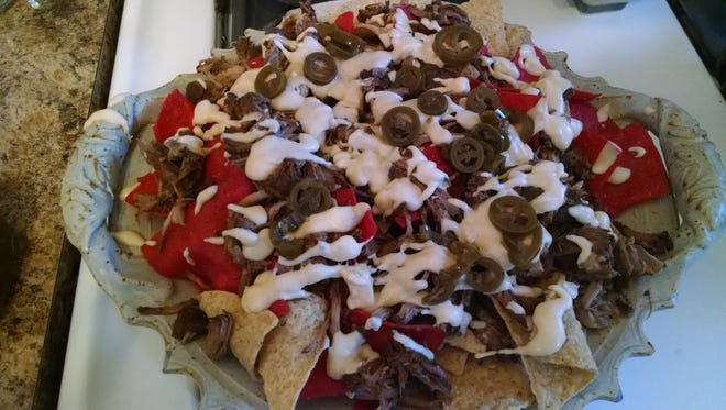 Pulled pork nachos should ease the pain of college basketball.