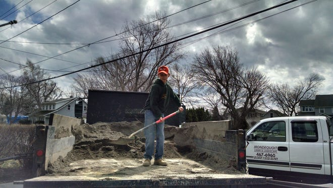 12-year-old son Andrew works at a job site.