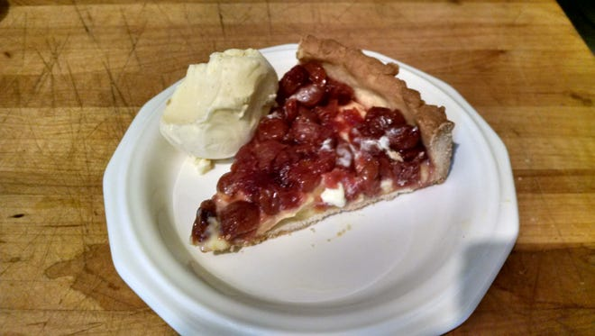 A sour cherry tart is enhanced with canned preserves.