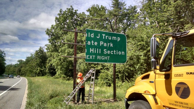 Strong winds Sunday blew off a panel on the Taconic State Parkway sign alerting motorists of the nearby Donald J. Trump State Park on Indian Hill.