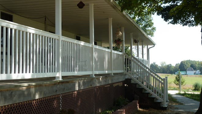 Lovina often likes to write her column from her front porch, as work winds down from the day or season.