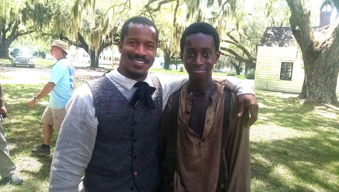 "Director-star Nate Parker  and Memphis actor Kai Norris on the Savannah set of ""The Birth of a Nation."""