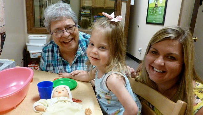 Isabella Goldsmith, pictured with mother Sarah Goldsmith, receives therapy from clinician Julie Borgreen at the Scottish Rite Childhood Language Disorders Clinic, which her great-grandfather Jack Eidel supported for 55 years.