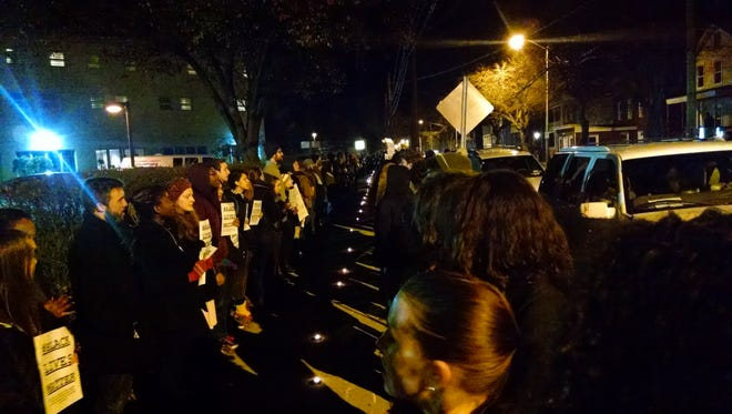 People gather to protest the Ferguson verdict outside of the Dutchess County Jail on North Hamilton Street in Poughkeepsie.