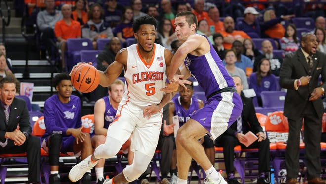 Clemson forward Jaron Blossomgame (5) drives to the basket against High Point at Littlejohn Coliseum, Friday, November 25, 2016.