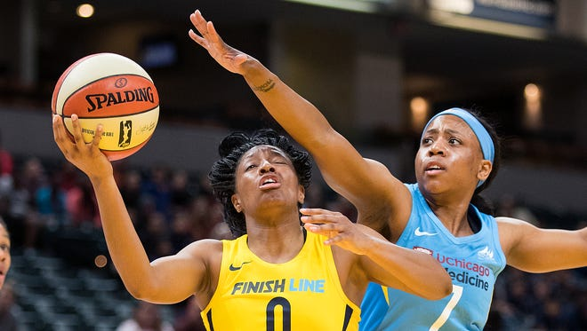 Indiana Fever guard Kelsey Mitchell (0) drives on Chicago Sky forward Ameryst Alston (7) in the first half of their WNBA preseason basketball game at Bankers Life Fieldhouse on Monday, May 7, 2018.