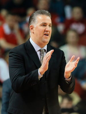 Purdue coach Matt Painter applauds his players during the first half of an NCAA college basketball game against Nebraska in Lincoln, Neb., Tuesday, March 1, 2016. (AP Photo/Nati Harnik)