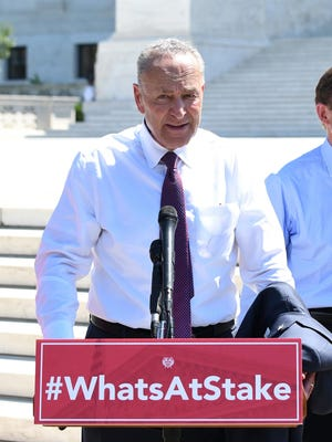 """Senate Minority Leader Chuck Schumer (D-N.Y.) speaks with Senate Democrats during a news conference to """"save women's reproductive rights and health care protections"""" in front of the Supreme Court, on July 10, 2018 in Washington, D.C. (Olivier Douliery/Abaca Press/TNS)"""