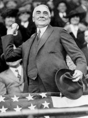 In this April 13, 1921, file photo, President Warren G. Harding throws out the first ball to open the Washington Senators' baseball season. The grandson of U.S. President Warren G. Harding has gone to court seeking to dig up the Republican's remains from the presidential memorial where they have lain since 1927.