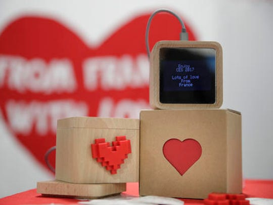 LoveBox devices are on display at CES International Friday, Jan. 6, 2017, in Las Vegas. The device is designed to receive private messages through an Internet connection.