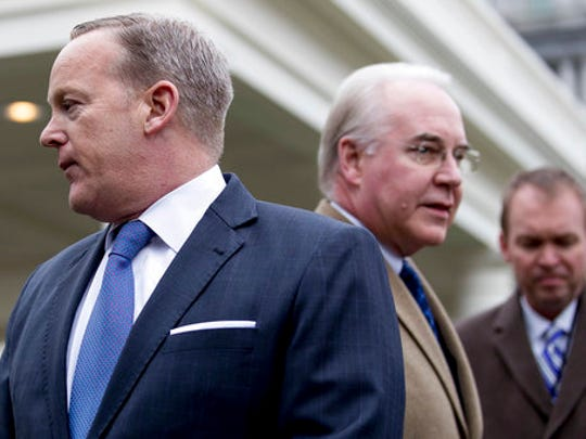 From left, White House press secretary Sean Spicer, Health and Human Services Secretary Tom Price, and Budget Director Mick Mulvaney, arrive to speak outside the West Wing of the White House in Washington, Monday, March 13, 2017, after Congress' nonpartisan budget analysts reported that 14 million people would lose coverage next year under the House bill dismantling former President Barack Obama's health care law.