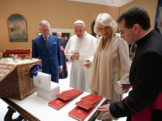 Pope Francis exchanges gifts with Britain's Prince