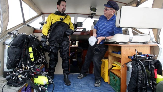 Diver Bob Martelli of Bay City, Mich., and shipwreck hunter David Trotter of Canton, Mich., talk about what Martelli saw and recorded at the Keystone State wreckage, which was close to 180 feet below them.