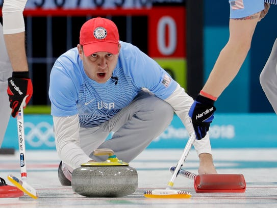 United States's skip John Shuster throws a stone during